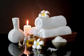 close-up-view-spa-treatment-accessories-with-white-towel-candle-aroma-oil_67155-5775